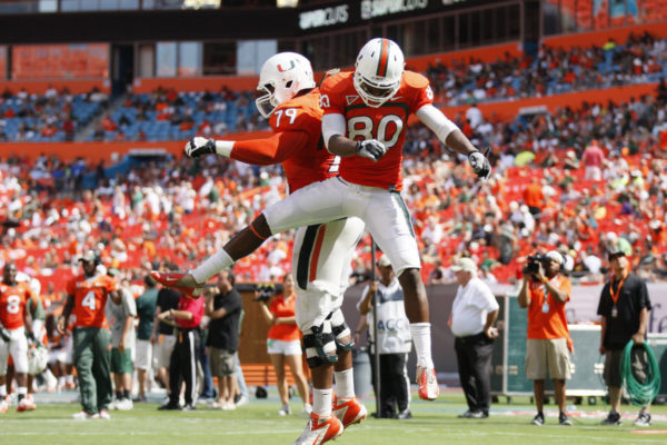 Miami players Rashawn Scott, right, and Malcolm Bunch, left, celebrate an orange team touchdown during the Hurricanes' spring football game at Sun Life Stadium Stadium in Miami, Florida, Saturday, April 13, 2013. (Gregory Castillo/Miami Herald/MCT via Getty Images)